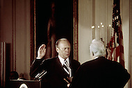 Gerald Ford sworn into office August 9th, 1974 Washington DC -  A break in at the Democratic National Committee headquarters at the Watergate complex on June 17, 1972 results in one of the biggest political scandals the US government has ever seen.  Effects of the scandal ultimately led to the resignation of  President Richard Nixon, on August 9, 1974, the first and only resignation of any U.S. President.