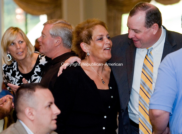 WATERBURY, CT - 09 JULY 2009 -070909JT13-<br /> Former Waterbury Police Superintendent Neil O'Leary greets Police Activity League volunteer and friend Ginny Szantyr at the Pontelandolfo Club in Waterbury on Thursday during O'Leary's retirement party. <br /> Josalee Thrift Republican-American