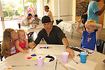 The Young and the Restless John Driscoll paints with Shamus and sister & mom at the Painting Party on May 15, 2011 on Marco Island, Florida - SWSL Soapfest Charity Weekend May 14 & !5, 2011 benefitting several children's charities including the Eimerman Center providing educational & outreach services for children for autism. see www.autismspeaks.org. (Photo by Sue Coflin/Max Photos)