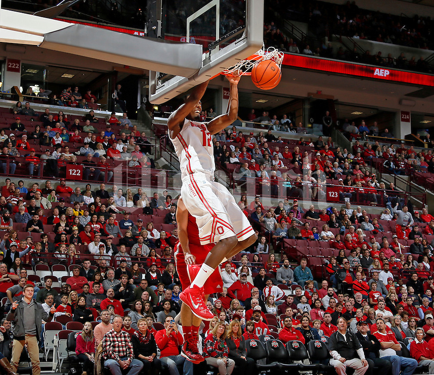 Ohio State Buckeyes forward Sam Thompson (12) throws down a dunk against Sacred Heart Pioneers as the 1st half ends during their NCAA game at Value City Arena in Columbus, Ohio on November 23, 2014.  (Dispatch photo by Kyle Robertson)