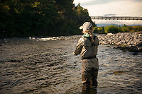 A woman fly fishes for trout beneath Major Jones Swing Bridge on the Tongariro River in Turangi on New Zealand's North Island.