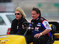 Apr. 1, 2012; Las Vegas, NV, USA: NHRA pro stock driver Larry Morgan (right) with wife Diane Morgan during the Summitracing.com Nationals at The Strip in Las Vegas. Mandatory Credit: Mark J. Rebilas-
