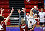 KENOSHA, WI - APRIL 28:  Springfield College's Sergio Figuroa Velez spikes on at the Stevens Institute defense at the Division III Men's Volleyball Championship held at the Tarble Athletic and Recreation Center on April 28, 2018 in Kenosha, Wisconsin. (Photo by Steve Woltmann/NCAA Photos via Getty Images)