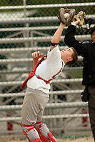 Catcher Nic Taylor catches a foul ball during a Little League game at Memorial Park in Belton, Missouri on May 6, 2006.