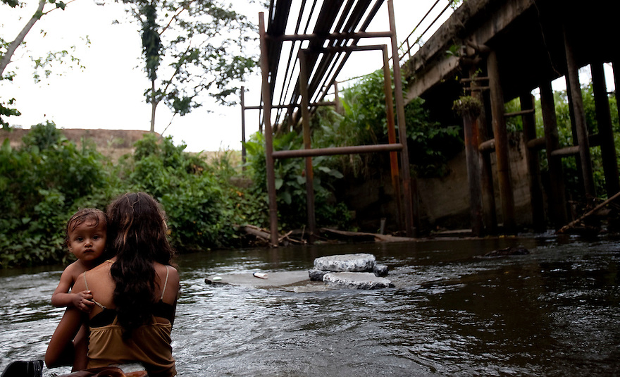 Residents still bathe and wash in a river they claim is contaminated in San Carlos.