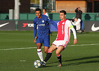 Enric Llansana of Ajax passes the ball upfield as Chelsea's Faustino Anjorin looks on during Chelsea Under-19 vs AFC Ajax Under-19, UEFA Youth League Football at the Cobham Training Ground on 5th November 2019