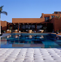 View of the swimming pool and terrace from the mattress seating of the pavilion