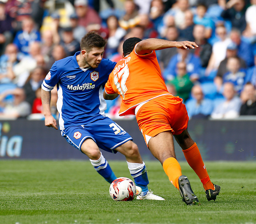 Cardiff City's Matthew Kennedy under pressure from Blackpool's Miles Addison<br /> <br /> Photographer Simon King/CameraSport<br /> <br /> Football - The Football League Sky Bet Championship - Cardiff City v Blackpool - Saturday 25th April 2015 - Cardiff City Stadium - Cardiff<br /> <br /> &copy; CameraSport - 43 Linden Ave. Countesthorpe. Leicester. England. LE8 5PG - Tel: +44 (0) 116 277 4147 - admin@camerasport.com - www.camerasport.com