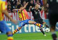 19.09.2012. Munich, Germany.  Munichs Arjen Robben (R) and Andres Guardado of Valencia challenge for the ball during the UEFA Champions League group F soccer match between Bayern Munich and Valencia CF at the football  Arena M in Munich, Germany, 19 September 2012.