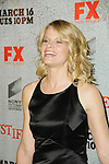 JOELLE CARTER. Arrivals to the premiere screening of the FX original drama series, Justified, at the Directors Guild of America. Los Angeles, CA, USA. March 8, 2010.