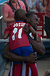 Atletico Madrid's new Colombian striker Jackson Martinez with his son during his presentation as new player of the Spanish Primera Division soccer club at Vicente Calderon stadium in Madrid, Spain. July 26, 2015. (ALTERPHOTOS/Victor Blanco)