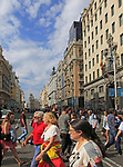 Pedestrians crossing busy road of Gran Via, Madrid city centre, Spain