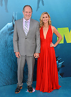 "LOS ANGELES, CA - August 06, 2018: Jon Turteltaub & Amy Eldon at the US premiere of ""The Meg"" at the TCL Chinese Theatre"