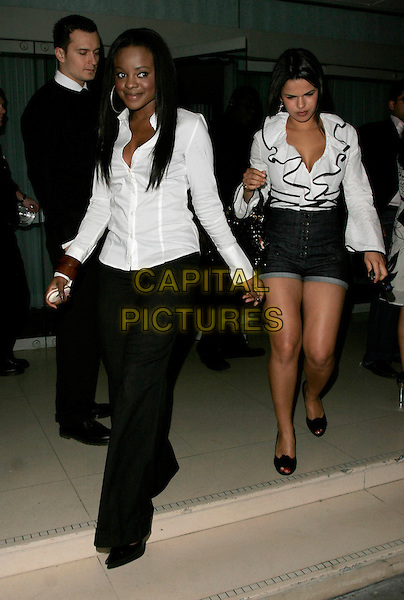 KEISHA BUCHANAN (SUGABABES) & EMILY ROSE.The Laurent-Perrier Pink Party, Suka, Sanderson Hotel, London, England..April 25th, 2007.full length black trousers white shirt blouse ruffles high waist jean denim shorts .CAP/AH.©Adam Houghton/Capital Pictures