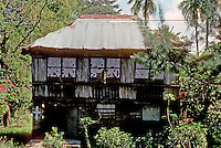 Philippines: Agoo--Traditional house with tin roof. Photo '82.