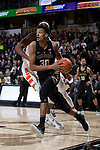 Olivier Sarr (30) of the Wake Forest Demon Deacons drives the baseline past Paschal Chukwu (13) of the Syracuse Orange during second half action at the LJVM Coliseum on January 3, 2018 in Winston-Salem, North Carolina.  The Demon Deacons defeated the Orange 73-67.  (Brian Westerholt/Sports On Film)