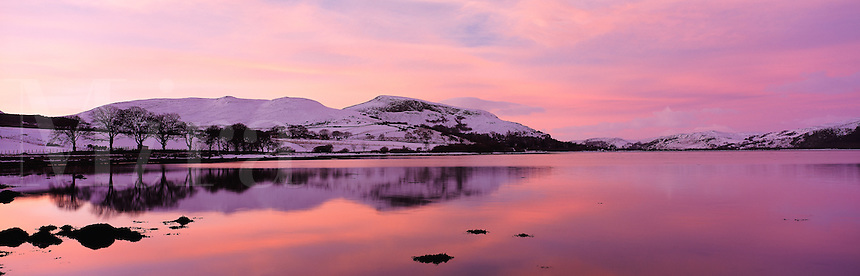 © David Paterson.Warm evening sky reflected in calm water in snow-covered landscape. Loch Fleet (Dornoch Firth), NE Scotland, with the Cambusmore Hills...Keywords: hills, range, lake, loch, evening, sunset, dusk, peace, quiet, tranquil, winter, cold, snow, Fleet, Golspie, Sutherland, Scotland, Highlands
