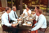 United States President Ronald Reagan has luncheon meeting with (from left to right) White House Chief of Staff James Baker III, Secretary of State George Shultz, William Clark and Ed Meese at Camp David, near Thurmont, Maryland on Saturday, June 26, 1982. .Mandatory Credit: Michael Evans - White House via CNP