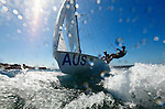 Day 2 of the Sail Sydney 2009 regatta, 470 Olympic class..Held annually Sail Sydney take place from the 5-8 December 2009 on the magnificent Sydney Harbour as part of the Sail Down Under series, incorporating Sail Brisbane, Sail Sydney and Sail Melbourne..Competitors from around the world bring Sydney Harbour to life as athletes look to establish themselves on the sailing scene in the lead up to the London Olympics in 2012..The four day regatta incorporate Olympic, International and Youth classes on the three Sydney Harbour courses used by the 2000 Sydney Olympics. Spectacular action from the 49er and International Moth classes can be expected along with the Laser, Laser Radial, Finn, RS:X and 470s as they campaign towards 2012..Over 400 participate and sail out of host venue: Woollahra Sailing Club in Rose Bay.
