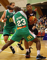 Heat guard BJ Anthony tries to get around Richard Jeter during the NBL match between Manawatu Jets and Harbour Heat at Arena Manawatu, Palmerston North, New Zealand on Saturday 17 April 2010. Photo: Dave Lintott / lintottphoto.co.nz