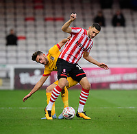 Lincoln City's James Wilson vies for possession with Northampton Town's Jack Bridge<br /> <br /> Photographer Chris Vaughan/CameraSport<br /> <br /> Emirates FA Cup First Round - Lincoln City v Northampton Town - Saturday 10th November 2018 - Sincil Bank - Lincoln<br />  <br /> World Copyright © 2018 CameraSport. All rights reserved. 43 Linden Ave. Countesthorpe. Leicester. England. LE8 5PG - Tel: +44 (0) 116 277 4147 - admin@camerasport.com - www.camerasport.com