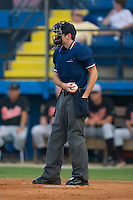 Home plate umpire Jeff Morrow reloads his ball bag during an Appalachian League contest between the Bluefield Orioles and the Burlington Royals at Burlington Athletic Park in Burlington, NC, Saturday, July 26, 2008. (Photo by Brian Westerholt / Four Seam Images)