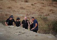 Pictured: Detective Inspector Jon Cousins (C) joins forensic archaeologists at the second site in Kos, Greece. Wednesday 12 October 2016<br />
