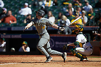 Alex Peterson (14) of the Missouri Tigers follows through on his swing against the Baylor Bears in game one of the 2020 Shriners Hospitals for Children College Classic at Minute Maid Park on February 28, 2020 in Houston, Texas. The Bears defeated the Tigers 4-2. (Brian Westerholt/Four Seam Images)