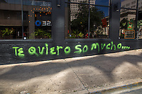 """Te quiero so mucho"" is a graffiti painting written in Spanish and a pun to the famous ""I love you so much"" painting on the side Jo's Coffee building on South Congress in downtown Austin, Texas - Stock Image."