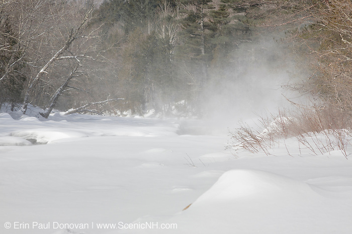 Strong winds blow snow up the East Branch of the Pemigewasset River in the Pemigewasset Wilderness of Lincoln, New Hampshire. This area was logged during the East Branch & Lincoln Railroad era (1893-1948).