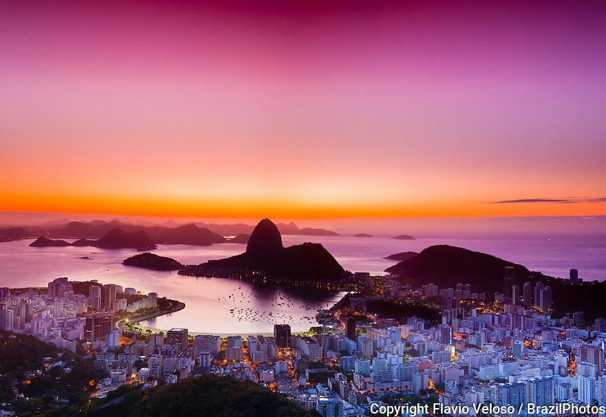 Sunrise in Rio de Janeiro, Brazil - Sugar Loaf mountain at entrance of Guanabara Bay with Enseada de Botafogo in the center and Botafogo neighborhood at right.