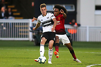 Mattias Kait of Fulham U23's passes the ball upfield under pressure from Manchester United U23's Tahith Chong during Fulham Under-23 vs Manchester United Under-23, Premier League 2 Football at Motspur Park on 10th August 2018