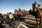 © Joel Goodman - 07973 332324 . 22/10/2016 . Margate , UK . Mounted police attempt to separate anti fascists and White Lives Matter marchers . A White Lives Matter protest and march , opposed by antifascists , is held in Margate , Kent . Photo credit : Joel Goodman