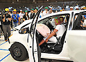 "July 21st, 2011, Susonosi, Japan - Reporters view a heavily damaged Toyota VITZ after a head-on collision with a Toyota Crown at the speed of 55km/h (about 34 miles/h) in a demonstration at Toyotas Higashi-Fuji Technical Center on the foot of Mt. Fuji, some 92km (about 57 miles) southwest of Tokyo, on Thursday, July 21, 2011. Toyota showed to reporters technologies aimed at increasing safety for pedestrians and elderly drivers, as part of its initiatives to eliminate traffic casualties. The technologies include a Pre-Collision System with collision-avoidance assist, glare-preventing adaptive driving beams and a pop-up hood for lessening pedestrian injury. In the PCS, Toyota uses cameras and a super sensitive radar called ""millimeter-wave,"" both installed in the front of the vehicle, to detect possible crashes such as a pedestrian crossing the road. Then the vehicle calculates how braking and steering must be applied to avoid a crash. (Photo by Natsuki Sakai/AFLO) [3615] -mis-"