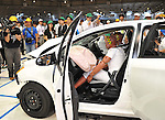 """July 21st, 2011, Susonosi, Japan - Reporters view a heavily damaged Toyota VITZ after a head-on collision with a Toyota Crown at the speed of 55km/h (about 34 miles/h) in a demonstration at Toyotas Higashi-Fuji Technical Center on the foot of Mt. Fuji, some 92km (about 57 miles) southwest of Tokyo, on Thursday, July 21, 2011. Toyota showed to reporters technologies aimed at increasing safety for pedestrians and elderly drivers, as part of its initiatives to eliminate traffic casualties. The technologies include a Pre-Collision System with collision-avoidance assist, glare-preventing adaptive driving beams and a pop-up hood for lessening pedestrian injury. In the PCS, Toyota uses cameras and a super sensitive radar called """"millimeter-wave,"""" both installed in the front of the vehicle, to detect possible crashes such as a pedestrian crossing the road. Then the vehicle calculates how braking and steering must be applied to avoid a crash. (Photo by Natsuki Sakai/AFLO) [3615] -mis-"""