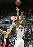 Nevada's Devonte Elliott shoots over Bucknell defender Mike Muscala during a second round NIT college basketball game in Reno, Nev. , on Sunday, March 18, 2012. Nevada won 75-67..Photo by Cathleen Allison