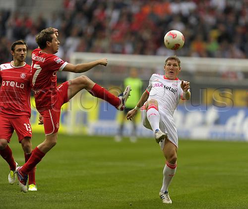 20.10.2012. Dusseldorf, Germany.  Dusseldorf versus  FC Bayern Munich. Andreas Lambertz Dusseldorf against Bastian Schweinsteiger Munich
