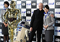 March 20, 2017, Tokyo, Japan - US movie Star Wars' C-3PO actor Anthony Daniels smiles with C-3PO, R2-D2 robots and ANA cabin attendants as he attends a presentation of All Nippon Airways (ANA) C-3PO jetliner at a hanger of ANA at Tokyo's Haneda airport on Monday, March 20, 2017. C-3PO designed Boeing 777-200 jet will start domestic flight service from March 21.    (Photo by Yoshio Tsunoda/AFLO) LwX -ytd-