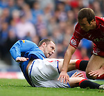 Kris Boyd tumbles in the box under pressure from Andrew Considine