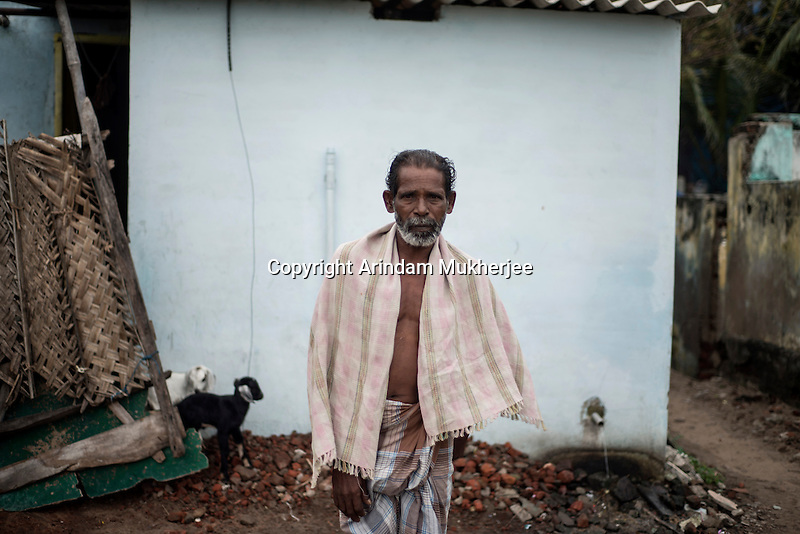 K. Pichandi (50 years) has rebuild his house in the same location where it used to be before 2004 Tsunami at Kichankuppam in Nagapattinam, Tamil Nadu, India.