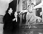Salvador Dali in London at an exhibition of his work in the Lefevre Galleries. The painting is called Madonna of Port Lligat for which his wife Gala is the model.<br />