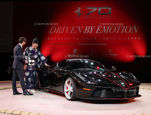 "October 12, 2017, Tokyo, Japan - Italian sports car maker Ferrari Japan managing director Reno de Paoli (L) and a sumo referee dislpay ""LaFerrari Aperta"" to celebrate Ferrari's 70th anniversary event at Tokyo's Kokugikan sumo gymnasium on Thursday, Octoebr 12, 2017. Ferrari also displayed 40 sports cars outside of the Kokugikan.   (Photo by Yoshio Tsunoda/AFLO) LWX -ytd"