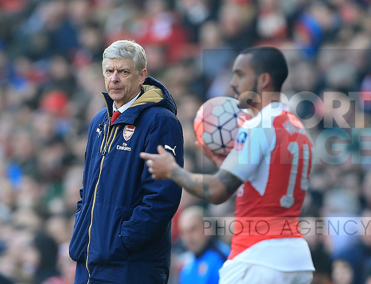 Arsenal's Arsene Wenger watches Theo Walcott during the Emirates FA Cup match at The Emirates Stadium.  Photo credit should read: David Klein/Sportimage