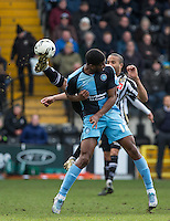 Thierry Audel of Notts County beats Rowan Liburd (Loanee from Reading) of Wycombe Wanderers to the ball during the Sky Bet League 2 match between Notts County and Wycombe Wanderers at Meadow Lane, Nottingham, England on 28 March 2016. Photo by Andy Rowland.