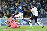 BOGOTA - COLOMBIA -15 -04-2015: Fernando Uribe (C) jugador de Millonarios disputa el balón con Ricardo Jerez (Izq) arquero y David Valencia Figueroa (Der) jugador de Alianza Petrolera durante partido por la fecha 15 de la Liga Águila I 2015 jugado en el estadio Nemesio Camacho El Campín de la ciudad de Bogotá./ Fernando Uribe (R) player of Millonarios fights for the ball with Ricardo Jerez (L) goalkeeper and David Valencia Figueroa (R) player of Alianza Petrolera during the match for the 15th date of the Aguila League I 2015 played at Nemesio Camacho El Campin stadium in Bogotá city. Photo: VizzorImage / Gabriel Aponte / Staff.