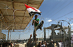 "Palestinians wave a national flag and an Egyptian flag as they take part in a rally calling on Egyptian authorities to open the Rafah crossing, outside the crossing in the southern Gaza Strip September 16, 2013. Cairo closed the Rafah crossing, Gaza's main window to the world, completely last week after assailants crashed two explosive-laden cars into a security building adjacent to the border zone, killing six Egyptian soldiers. Ashraf al-Qidra, spokesman for the Hamas-run Gaza Health Ministry, said 1,000 patients a month required medical care in Egypt and in other countries. Rafah's closure, he said, would also affect the import of medication and prevent foreign doctors from visiting Gaza. The signs read, ""We Gaza is deprived of power and fuel"" (L) and ""We demand the Egyptian side to find alternatives for the closure of tunnels. Photo by Eyad Al Baba"