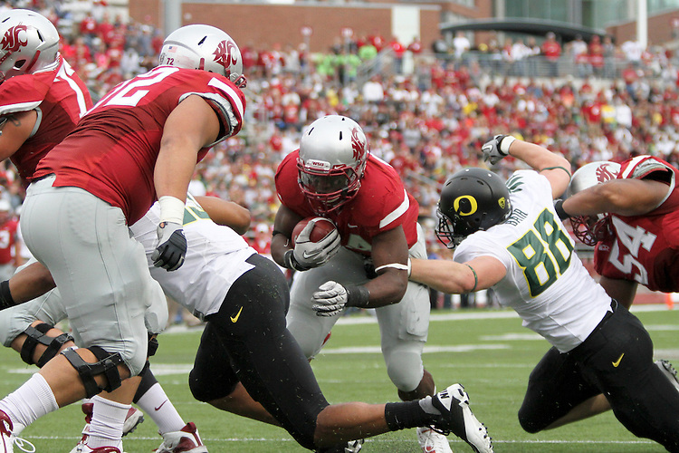 Washington State running back, Logwone Mitz (#34), blasts towards the endzone during the Cougars Pac-10 conference tilt with Oregon at Martin Stadium in Pullman, Washington, on October 9, 2010.  The Ducks broke open a tight game in the fourth quarter to win, 43-23.