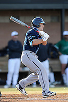 Left fielder Drew DeKerlegand (1) of the Citadel batsin a game against the University of South Carolina Upstate Spartans on Tuesday, February, 18, 2014, at Cleveland S. Harley Park in Spartanburg, South Carolina. Upstate won, 6-2. (Tom Priddy/Four Seam Images)