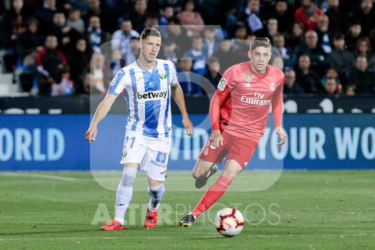 CD Leganes's Ruben Perez and Real Madrid's Federico Valverde during La Liga match between CD Leganes and Real Madrid at Butarque Stadium in Leganes, Spain. April 15, 2019. (ALTERPHOTOS/A. Perez Meca)