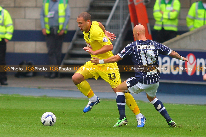 Joel Lynch of Huddersfield Town and Richard Chaplow of Millwalll - Millwall vs Huddersfield Town - Sky Bet Championship Football at the New Den, South Bermondsey, London - 17/08/13 - MANDATORY CREDIT: George Phillipou/TGSPHOTO - Self billing applies where appropriate - 0845 094 6026 - contact@tgsphoto.co.uk - NO UNPAID USE